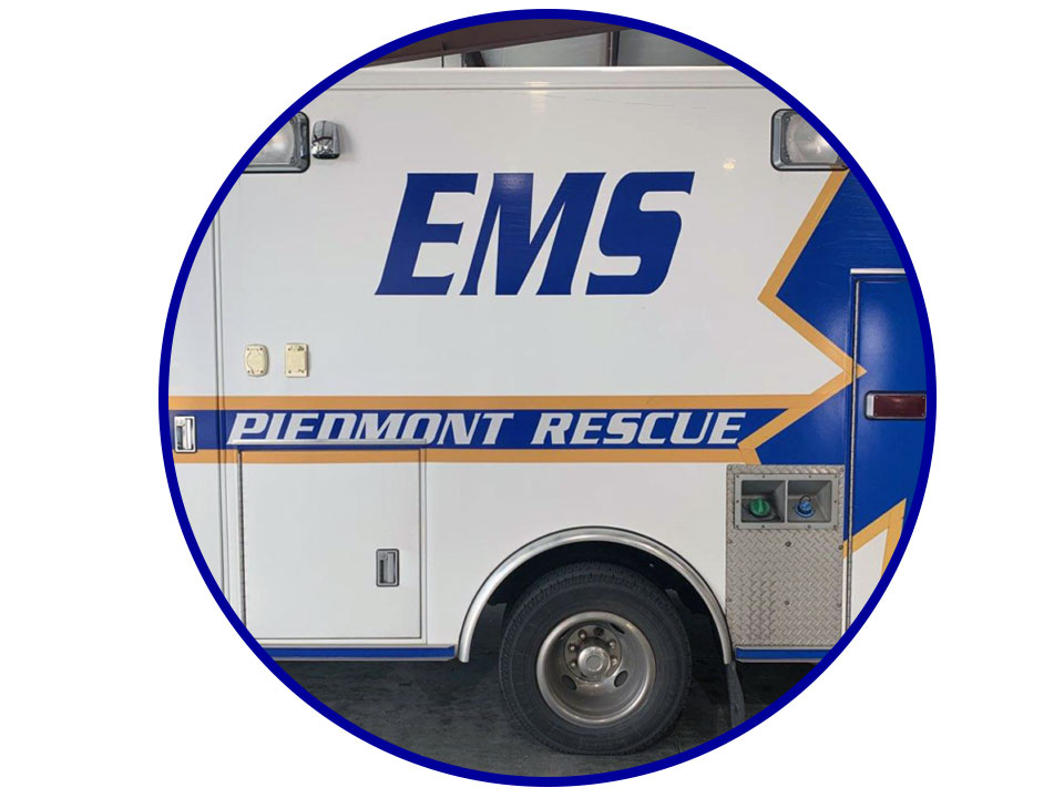 white and blue ems ambulance vehicle