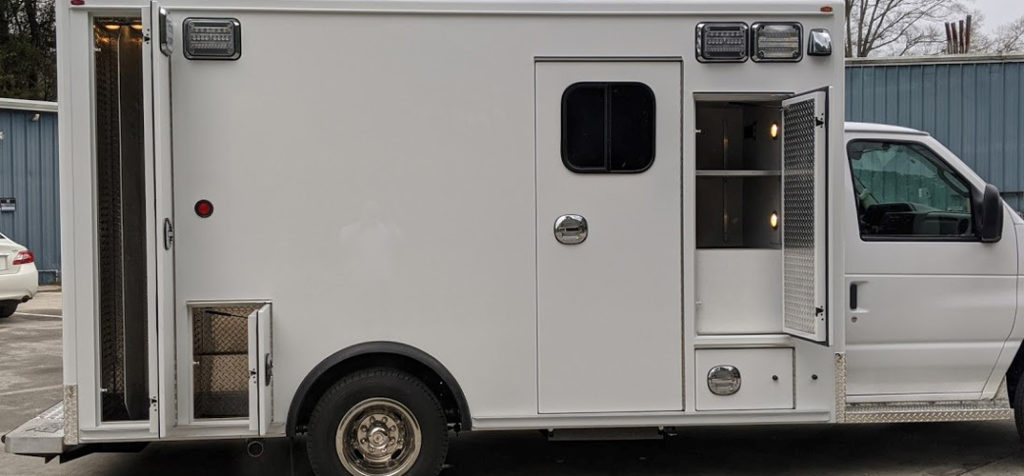 white ford e450 ambulance for sale with all doors open